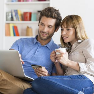 holiday budget couple shopping online